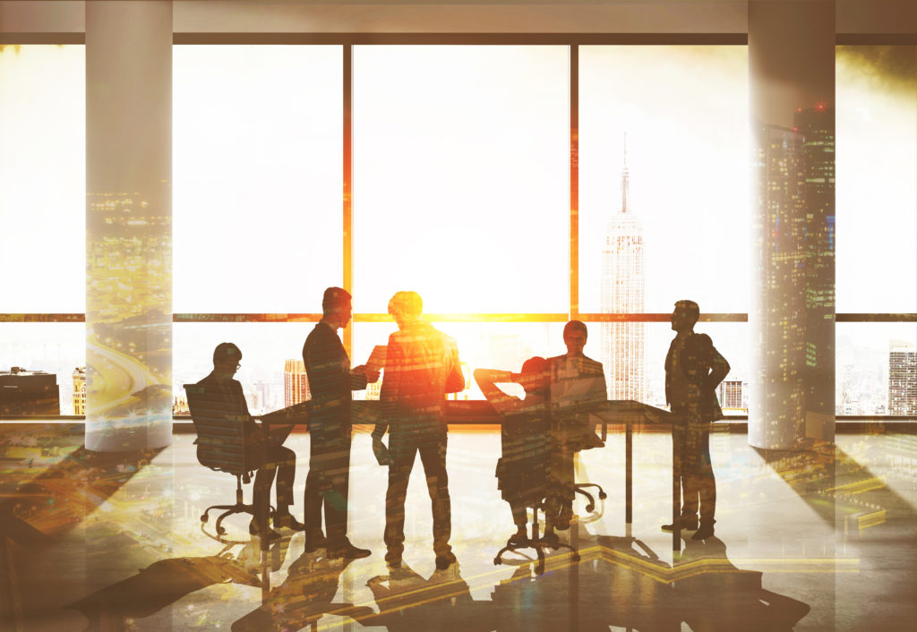 family office services in a conference room with clients